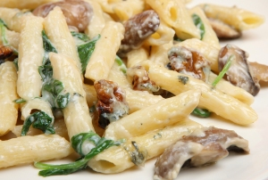 Rigatoni pasta florentine with four cheese sauce mushrooms walnuts and spinach
